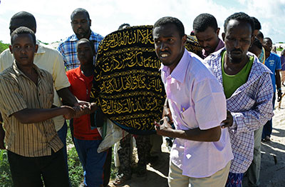 Mourners carry the coffin of Somali journalist Mohamed Ibrahim Raage in Jazira on the outskirts of Mogadishu on Monday. (AFP/Mohamed Abdiwahab)