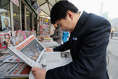 A man reads the Southern Weekly cover story at a newsstand in Beijing on January 10. (Reuters/Jason Lee)
