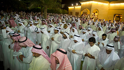Supporters of Kuwaiti opposition politician Musallam al-Barrak pray in the yard of his house in Andulos, after he was sentenced to jail for insulting the emir, April 15. (Reuters/Stephanie McGehee)