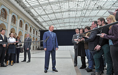 Vladimir Putin speaks to the media following a live nationwide broadcast phone-in, in Moscow Thursday. (Reuters/Mikhail Klimentyev/RIA Novosti)