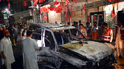 The site of a suicide bombing in Peshawar today, where more than 20 people, including at least one journalist, were killed. (AFP/A. Majeed)