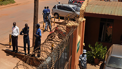 Police stand outside the offices of the Daily Monitor. (Daily Monitor)