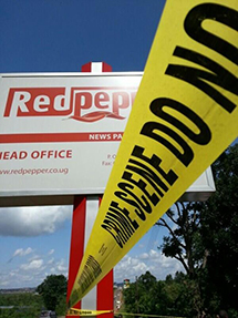 Yellow crime scene tape cordons off the offices of Red Pepper. (Patrick Mugumya)