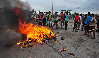 Hifazat-e-Islam protesters set fire to wood and tires during demonstrations earlier this week. (Reuters)