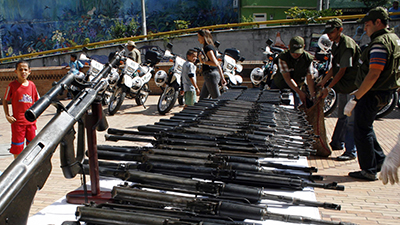 Colombian police display weapons confiscated during a raid on a criminal gang in the town of Tarazá. (Reuters/Fredy Amariles)