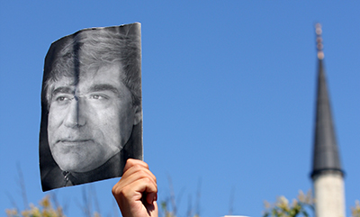 A protester holds up a photo of Turkish-Armenian editor Hrant Dink in Istanbul. (AFP/Bulent Kilic)
