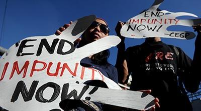 Activists protest impunity in journalist murders in the Philippines. (AFP/Noel Celis)