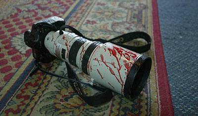 A blood-spattered camera in a Baghdad hotel. (AFP/Patrick Baz)