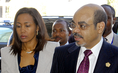 A journalist is being harassed in connection with a seven-month-old story about Azeb Mesfin, seen here with her husband, the late leader Meles Zenawi. (AP/Samson Haileyesus)