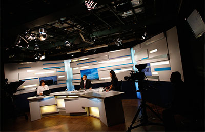 Leopoldo Castillo, center, pauses during his daily broadcast  of 'Alo Ciudadano' Tuesday on Globovisión. (Reuters/Jorge Silva)