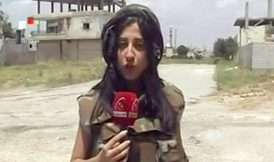 A screen grab from Syrian state TV shows Yara Abbas reporting from the city of Al-Qusayr. (AFP/Syrian TV)