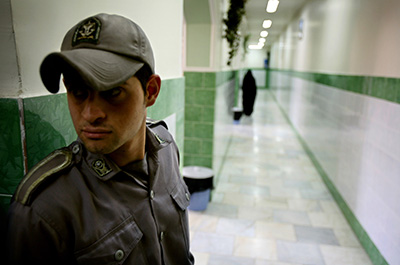 A prison official guards a corridor in Tehran's Evin Prison, where many journalists have been jailed over the years. (Reuters)