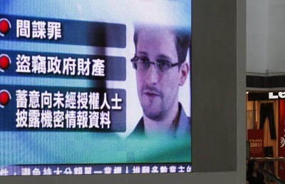 In a Hong Kong mall, a television monitor shows Snowden. (Reuters/Bobby Yip)