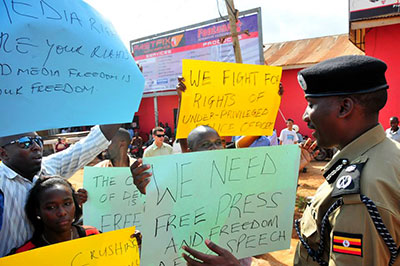 Journalists and activists protested the police siege of The Monitor. (Daily Monitor)