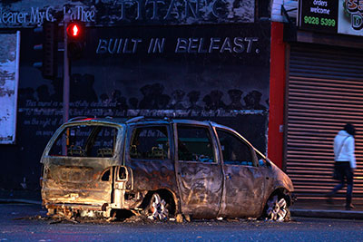 A burnt out car blocks Dee Street in east Belfast in January. Threats against journalists have increased since a wave of protests early this year. (Reuters/Cathal McNaughton)