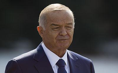 President Islam Karimov pledges to address the concerns of Uzbek journalists. (AP/Alexander Zemlianichenko)