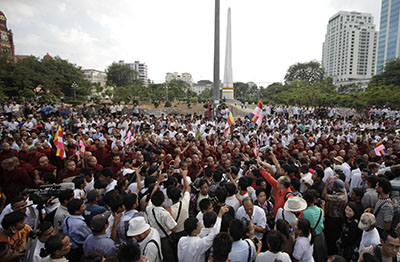 Buddhist monks protest in Rangoon in support of demonstrators injured at a rally at a copper mine. (Reuters/Soe Zeya Tun)