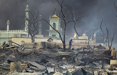 A mosque burns amid clashes between Buddhist monks and Muslims in the town of Meikhtila. (Reuters/Soe Zeya Tun)