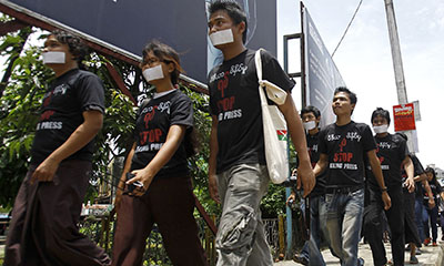 """Burmese journalists stage a protest called """"Stop Killing Press"""" in Rangoon. (AFP/Ye Aunt Thu)"""