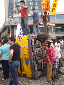 Protesters have attacked news vans, accusing outlets of covering the demonstrations from the government's perspective. (CPJ)
