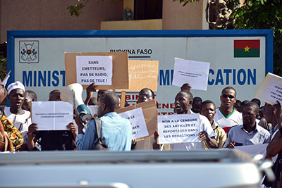 Journalists working for state media protest Tuesday in front of the Communications Ministry in Ouagadougou against authorities' meddling in their work. (AFP/Ahmed Ouoba)