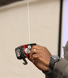 Ndebele demonstrates a hand-cranked radio. (Liesl Frankson/Wits Vuvuzela)