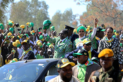 Zimbabwean President Robert Mugabe and his wife Grace greet party supporters on their arrival at a campaign rally in Chitungiwiza, Zimbabwe, on Tuesday. (AP/Tsvangirayi Mukwazhi)