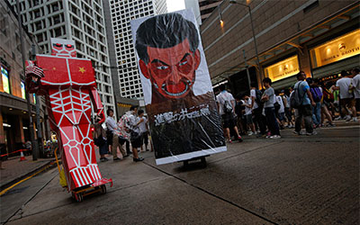A defaced picture of Hong Kong Chief Executive Leung Chun-ying is displayed during an annual pro-democracy protests in Hong Kong on July 1.(AP/Vincent Yu)