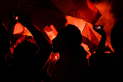 Opponents of Mohammed Morsi wave national flags at a protest outside the presidential palace in Cairo on Monday. (AP/Nariman El-Mofty)
