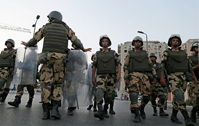 Military special forces march to surround supporters of Mohammed Morsi in Nasr City, Cairo, on Wednesday. (AP/Hassan Ammar)
