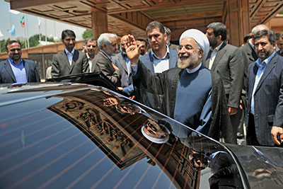 Hassan Rouhani leaves a conference in Tehran on June 29. Iran's president-elect called his win in national elections this month a vote for change. (AP/Office of the President-elect)
