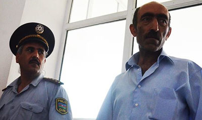 Editor Sardar Alibeili, right, has been sentenced to four years in prison. (IRFS)