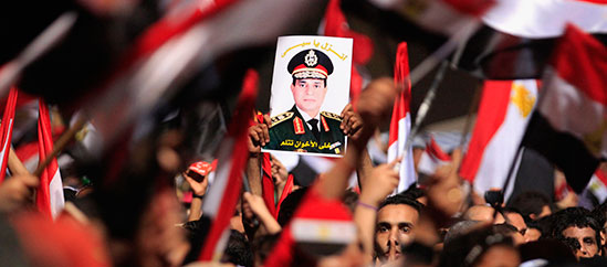 At a Tahrir Square rally, an image of al-Sisi. (Reuters/Mohamed Abd El Ghany)