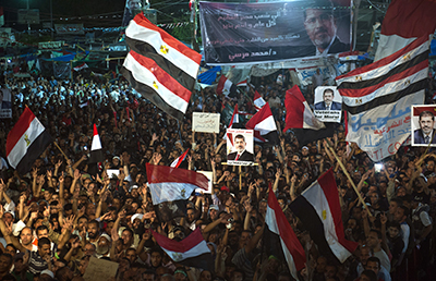 Members of the Muslim Brotherhood and supporters of ousted President Mohammed Morsi participate in a sit-in outside the Rabaa al-Adawiya mosque. (AFP/Khaled Desouki)