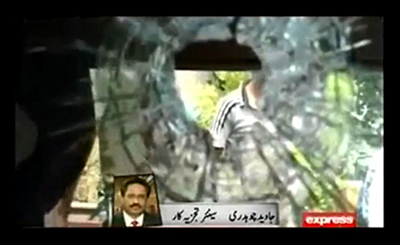 An Express TV report shows the damage left by today's attack on the Express Media Group. (YouTube/Express TV)