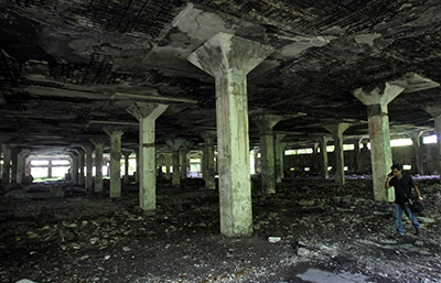 Police say a 22-year-old photographer was raped in this abandoned textile mill. (AP/Rafiq Maqbool)
