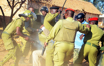 Police fired a tear canister during a September 2012 altercation outside Iringa, killing  journalist Daudi Mwangosi. (Wavuti)
