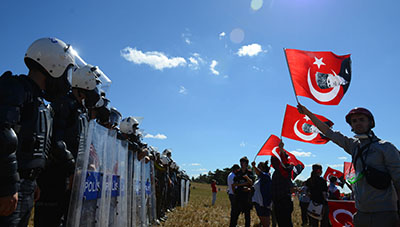 Protesters demonstrate outside the courthouse on Monday, where several journalists were among those convicted for participation in the alleged Ergenekon plot. (AP)