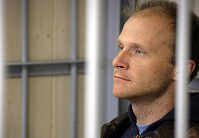 Freelance photographer Denis Sinyakov sits in a defendant cage in court on Thursday. (AFP/Greenpeace/Igor Podgorny)