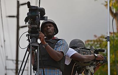 Kenyan journalists film outside the Westgate mall in September. (AFP/Carl de Souza)