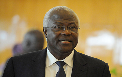 Two journalists are being held on libel charges after writing a critical article on President Koroma, seen here. (AFP/Pius Utomi Ekpei)