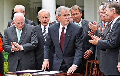 President George W. Bush is applauded after signing the FISA Amendments Act of 2008 in the White House Rose Garden. (AP/Ron Edmonds)