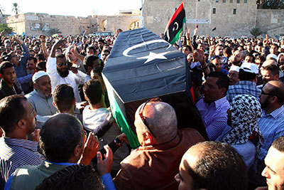 Mourners carry the coffin of one of the victims of a shootout the previous day at an anti-militia protest in Tripoli, on November 16, 2013. (AFP)