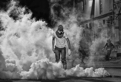 This photo of an anti-government protester by Ahmed Al-Fardan won first place in Freedom House's annual photo contest in April 2013. (Ahmed Al-Fardan)