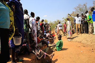 Families displaced by fighting wait to be registered for food rations at a makeshift camp inside a United Nations facility on the outskirts of Juba on Monday. (Reuters/James Akena)