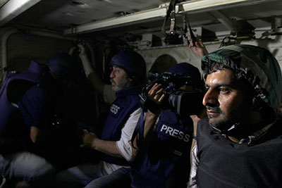 Journalists ride in an army soldiers' carrier to the front line during clashes between forces loyal to Syrian President Bashar al-Assad and opposition fighters on August 24, 2013. (Reuters/Khaled al-Hariri)
