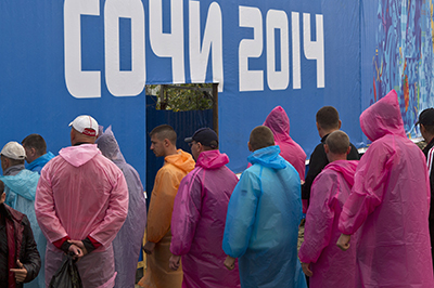Laborers stand in line to enter the Olympic Park in Sochi. (Reuters/Maxim Shemetov)