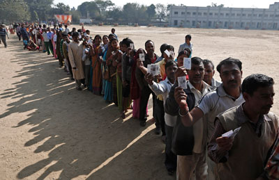 Voters queue at a polling station during the state assembly election in New Delhi on December 4, 2013. A major election is due in May. (Reuters/Adnan Abidi)