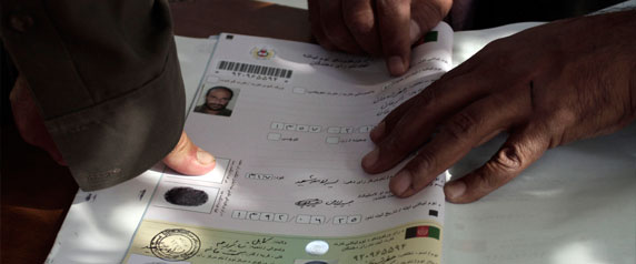 An Afghan man marks his application for voter registration in Kabul, Afghanistan, on September 16, 2013. Journalists' future may hinge on the presidential election scheduled for April 2014. (AP/Rahmat Gul)