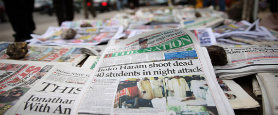 A newspaper displayed in the Ikoyi district of Lagos on September 30, 2013, tells of a deadly attack on a college in northeast Nigeria by suspected Boko Haram militants. Coverage of the group can be sensitive in Nigeria. (Reuters/Akintunde Akinleye)
